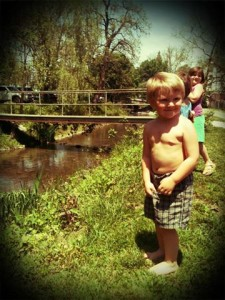 Rebel Toddler, checking the creek for water snakes